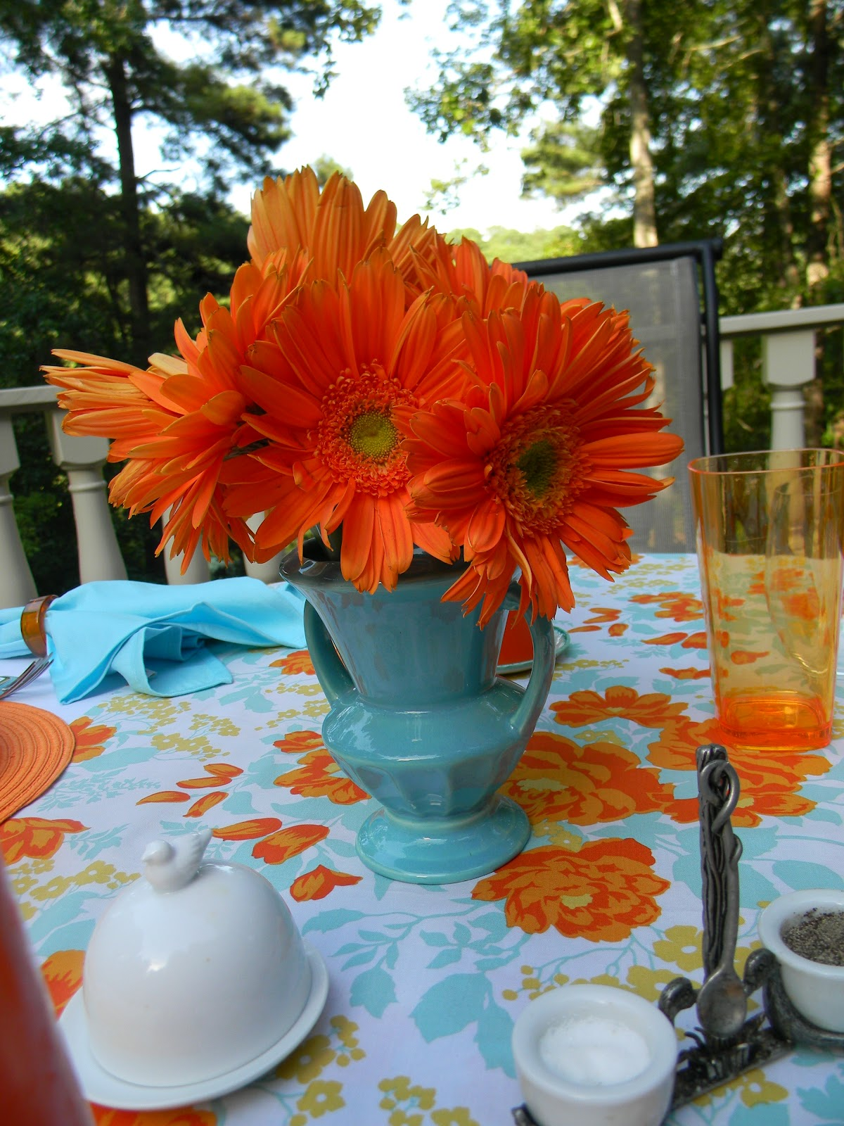 A Toile Tale Turquoise And Orange Table