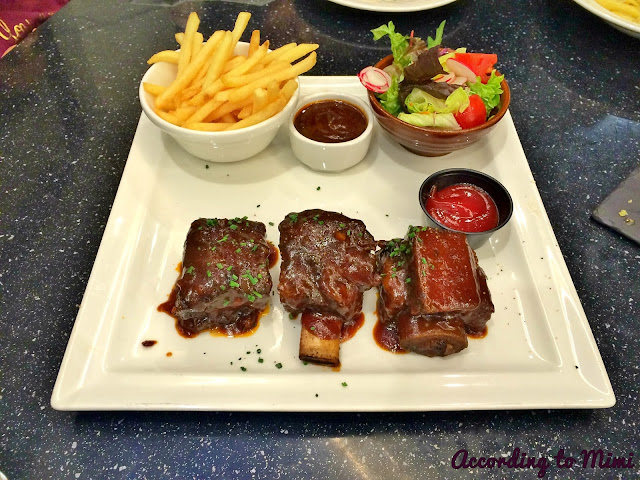Dean & Deluca's BBQ Ribs with a side of fries and a small salad