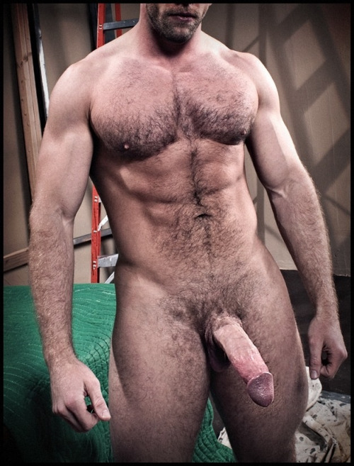 Muscular man with a large hairy cock