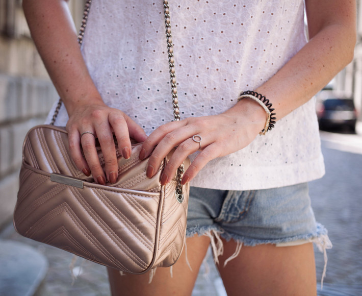 Outfit: eyelet top, denim cutoffs, rosegold purse