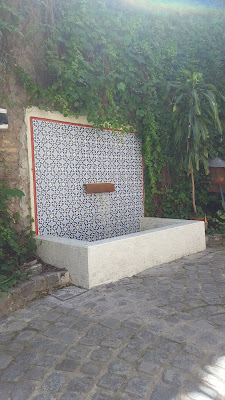 Patio fountain on wall