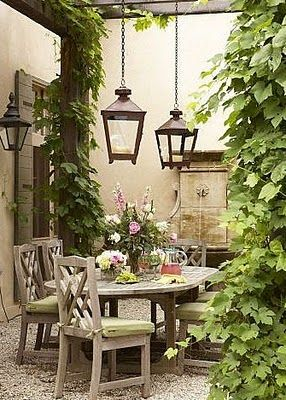 Breathtaking European outdoor garden dining room found on Hello Lovely Studio