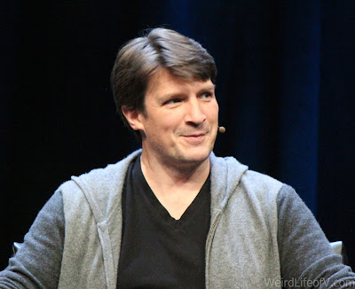 Nathan Fillion looking very cheeky