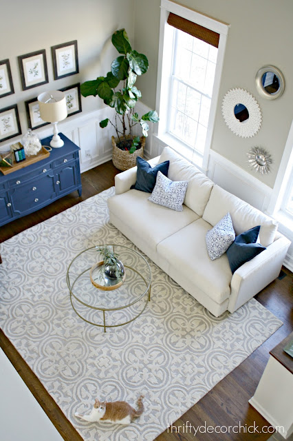 Neutral sofa round coffee table in living room