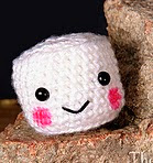 http://www.ravelry.com/patterns/library/campfire-the-mini-marshmallow-amigurumi
