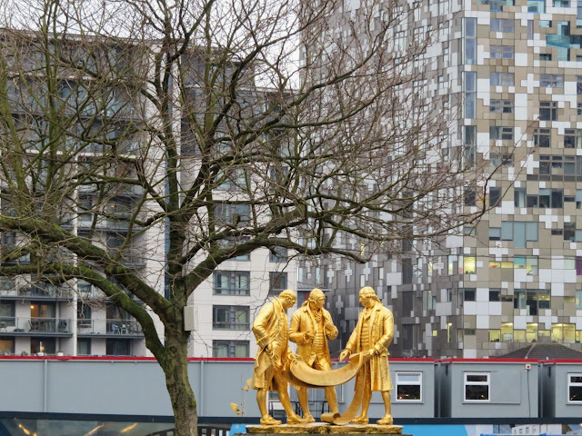Golden statue of Matthew Boulton, James Watt and William Murdoch in Birmingham, England