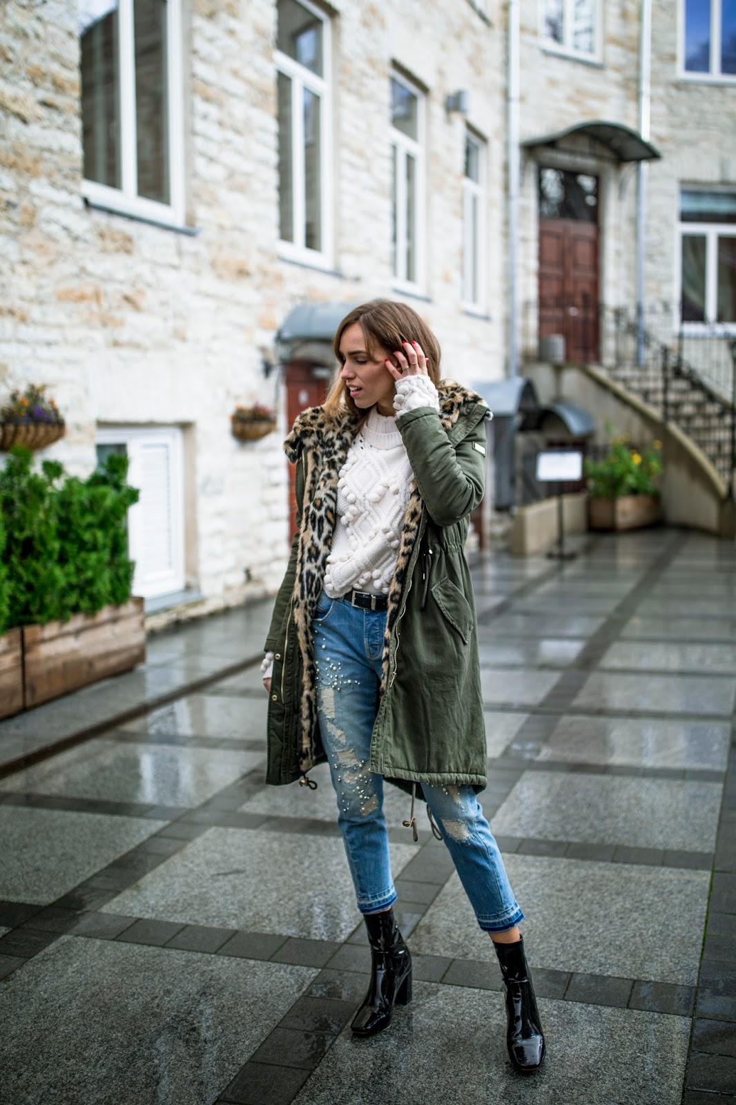 green parka jacket outfit sweater jeans heels
