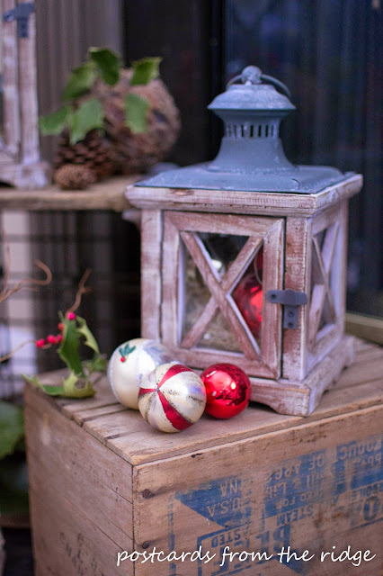 wood lantern with vintage mercury glass ornaments