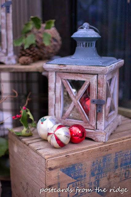 wood lantern with vintage mercury glass ornaments