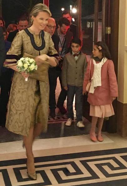 Queen Mathilde wore Dries Van Noten coat and dress gold metallic dress. metallic shoes, gold diamond earrings