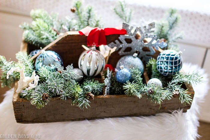 Rustic tool tray with sparkly ornnaments