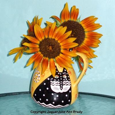 Some Final Autumn Beauty Sunflowers in a Laurel Burch Cat Vase