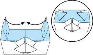 Bước 13: Gấp các cạnh giấy vào trong như hình vẽ