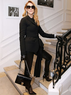 Celine Dion at Dior Haute Couture 2016/17 show in a black blazer and black trousers