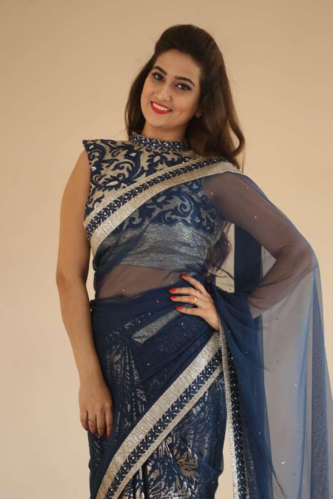 Glamorous Anchor Manjusha Hot Hip Show Stills In Blue Saree