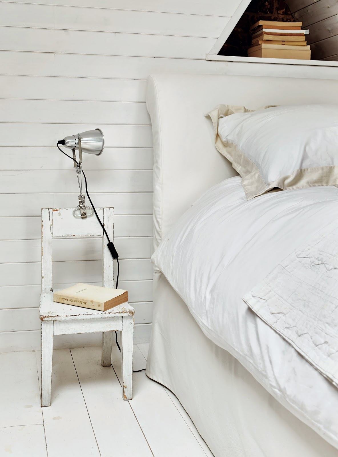 chair next to bed as nightstand