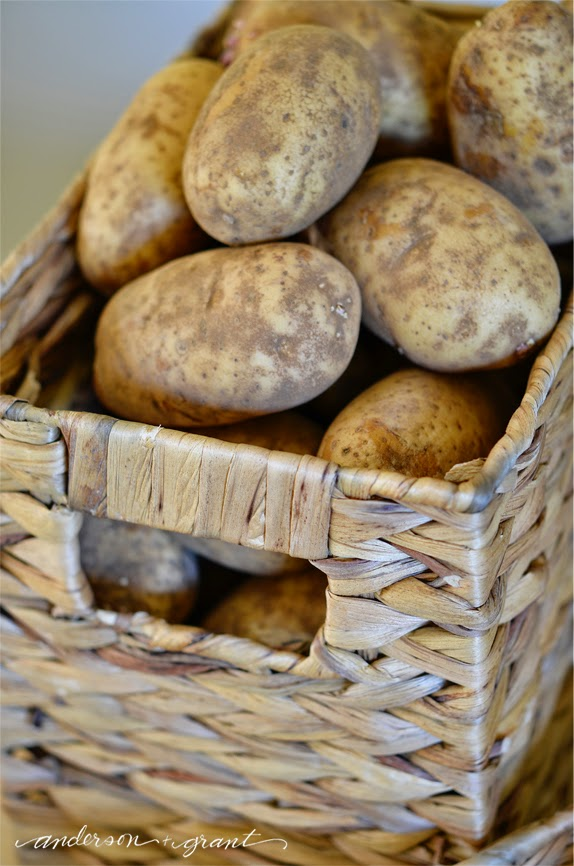 Storing potatoes and onions in baskets in the kitchen #organizing | www.andersonandgrant.com