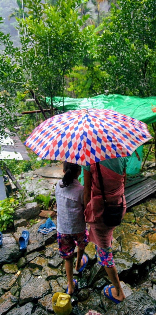 Rain and colorful umbrellas at Nongthymmai village, Meghalaya