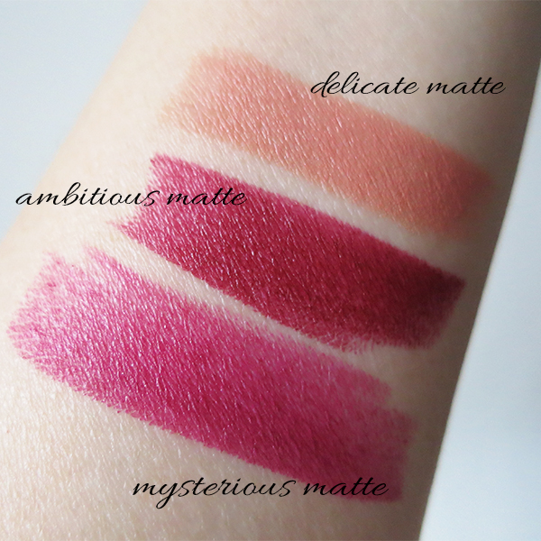 Swatches of Rouge Dior lipstick in 897 Mysterious Matte, 964 Ambitious Matte, and 136 Delicate Matte
