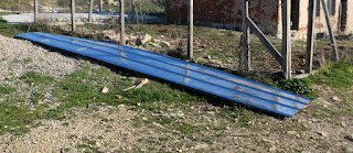 Four meter lengths of corrugated metal for the roof of the chicken house