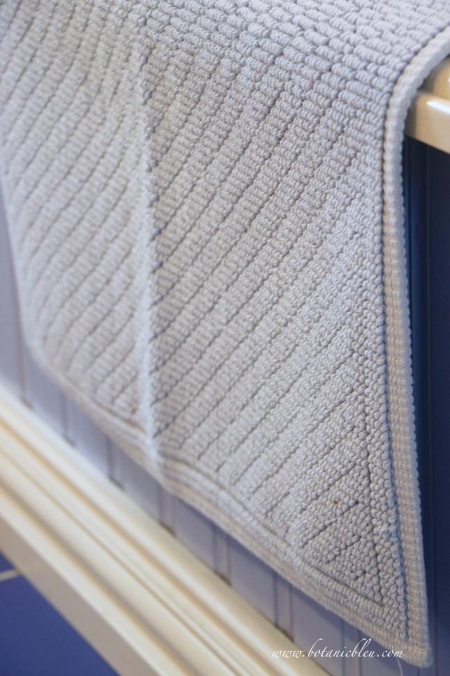 add French Country style with inexpensive cotton bath mats in a master bath