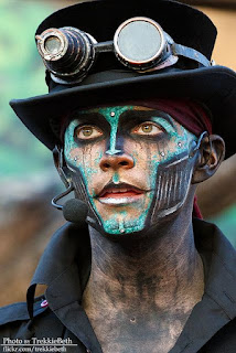 Men's Steampunk makeup for costumes or cosplay or halloween. Cyberpunk style robot with bright blue face paint and metal jaw.
