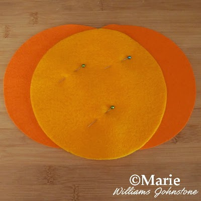 Pinned orange felt fabric