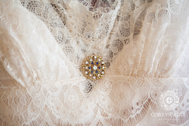 sapphire and diamond pin on bride's dress | Corey Cagle Photography