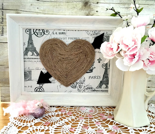twine wrapped heart on a Paris motif fabric with thrifted frame