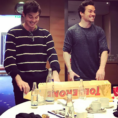 PLL actors Tyler Blackburn and Ian Harding with huge Toblerone chocolate bar in Germany