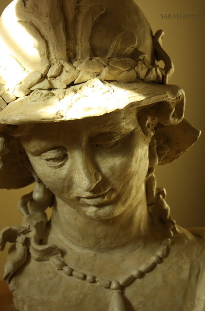 sculpture, art, artist, Minerva, Magarita, Trip, Sarah, Myers, woman, head, figurative, classic, life-size, Ferdinand, Bol, ceramic, stoneware, large, big, gentle, beauty, pearls, necklace, earrings, helmet, mythology, Athena, Pallas, eyes, bust, arte, escultura, ceramica, handwork, 3D, detail, close-up, face, eyes, glance, hair, lion, jewellery, jewelry, pendant, hat, wreath, serene