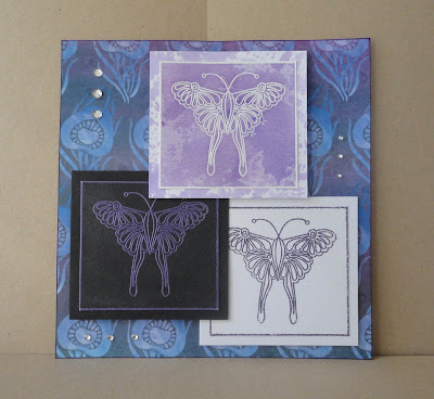 Three square butterfly images in shades of purple on purple patterned background