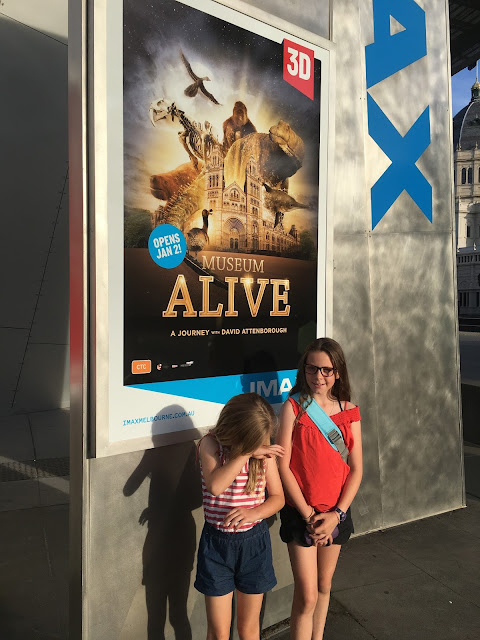 Girls in front of Museum Alive IMAX sign Melbourne