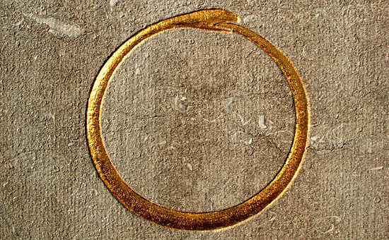 Photo (cropped) of Ouroboros - Alviella Goblet Mausoleum. Taken by WikiCommons user EmDee (May 27, 2012)