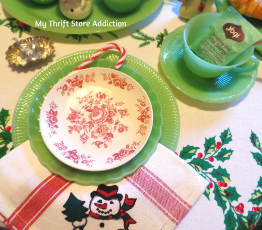 A Holly Jolly Jadeite Kitchen mythriftstoreaddiction.blogspot.com Jadeite table setting with vintage ornaments and snowman napkins