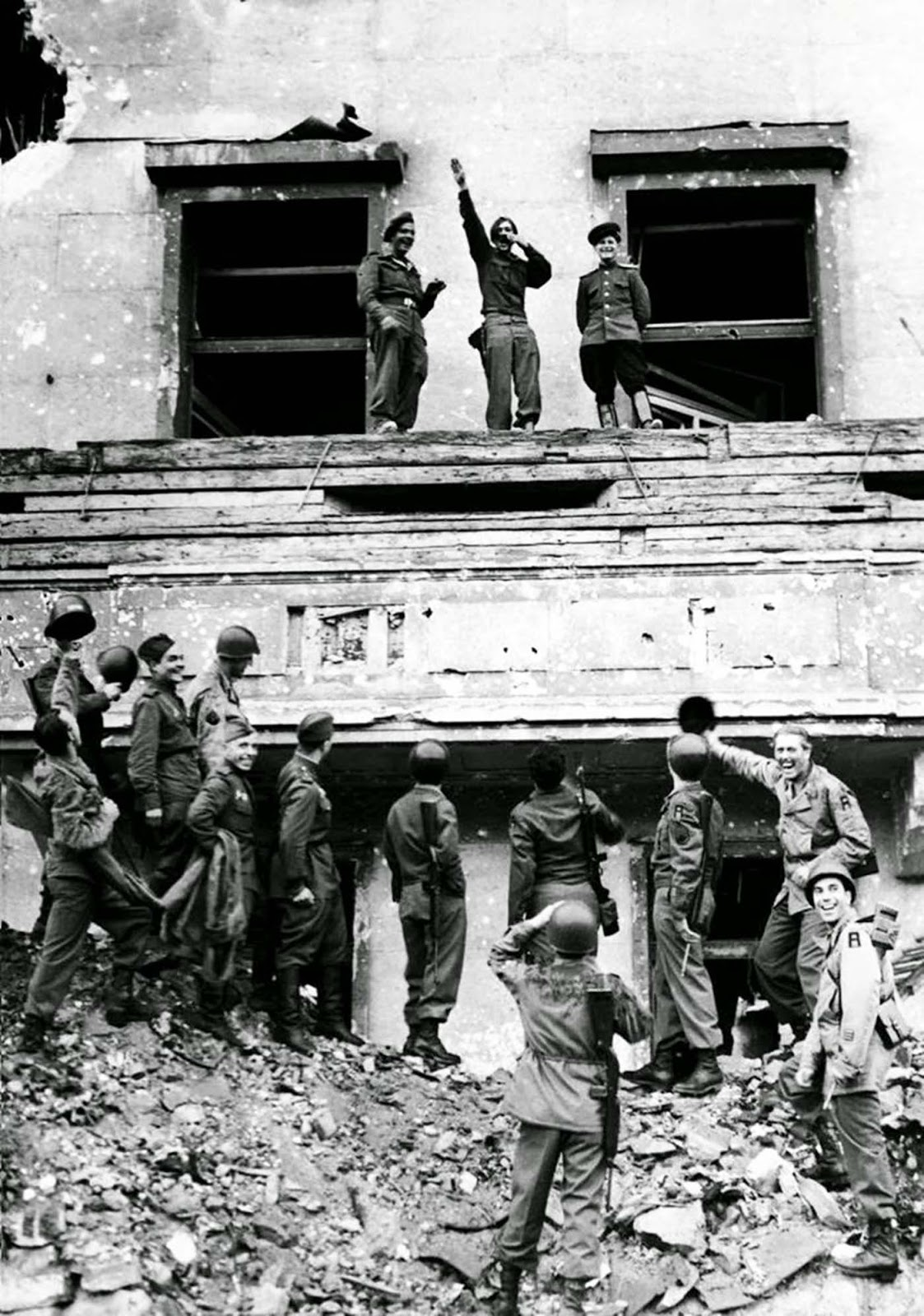 Soldiers of the British, American and Russian armies mimic and mock Adolf Hitler and his ideas on Hitler's famous balcony at the Chancellery in conquered Berlin.