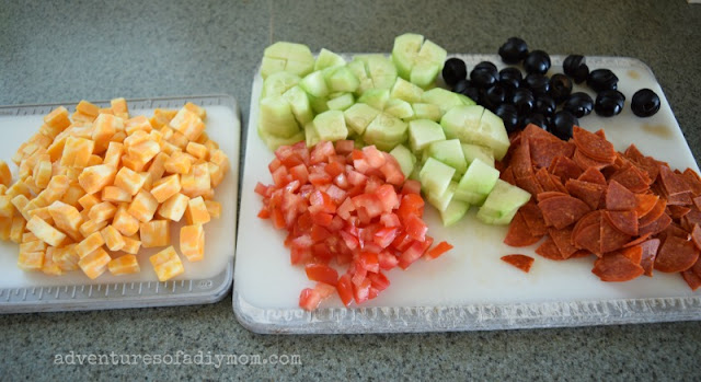pasta salad ingredients - pepperoni, cheese, tomato, olives, cucumber