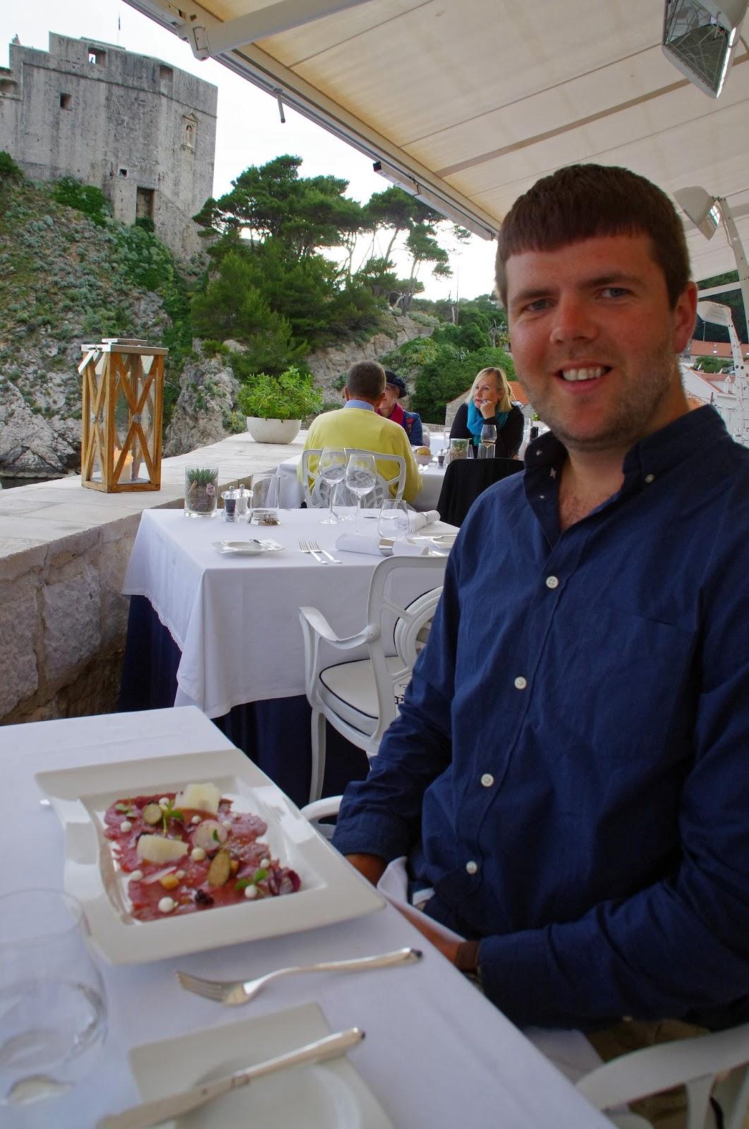 Dan with entree Nautika Restaurant Dubrovnik