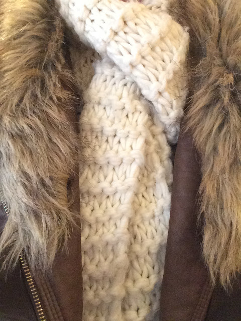 A thick woolly scarf