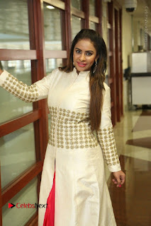 Telugu Actress Sri Reddy Mallidi Stills in White Beautiful Dress at Marriage Needs Bridal Fashion Week 2017 Logo Launch  0014.JPG
