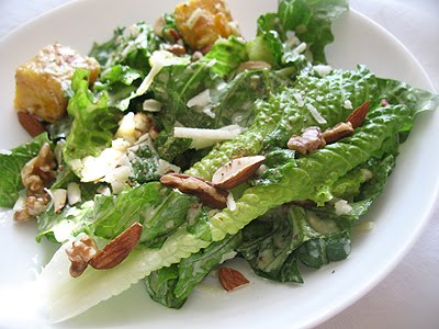 vegetarian Caesar salad with toasted nuts and fine quality olive oil and vinegar