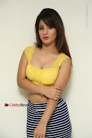 Cute Telugu Actress Shunaya Solanki High Definition Spicy Pos in Yellow Top and Skirt  0046.JPG
