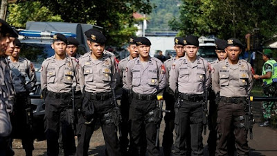 Indonesian Police Officers in Cilacap, Central Java, off Nusakambangan penal island