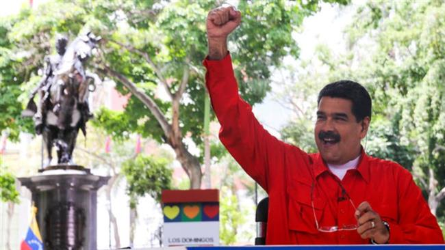 Venezuela's President Nicolas Maduro vows to go ahead with referendum despite 'imperial' threats