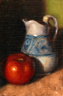 Oil painting of a red tomato beside a blue and white porcelain jug.