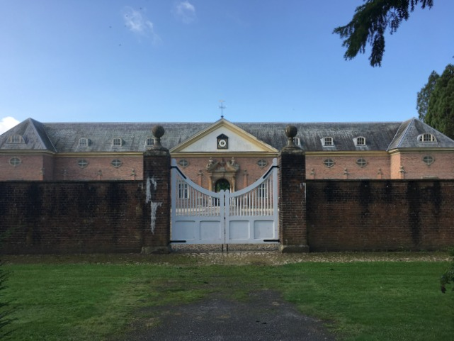 tredegar-house-stables-with-white-gate-in-front
