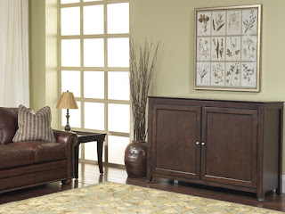 The Touchstone Monterey TV Lift Cabinet tastefully hides a large flat screen television.