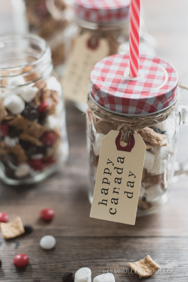 Canada Day S'more Snack Mix in a Mug Party Favor | A fun and festive snack mix packed into a mason jar mug with a stamped shipping tag label.  A party favor to enjoy both now and later. | personallyandrea.com