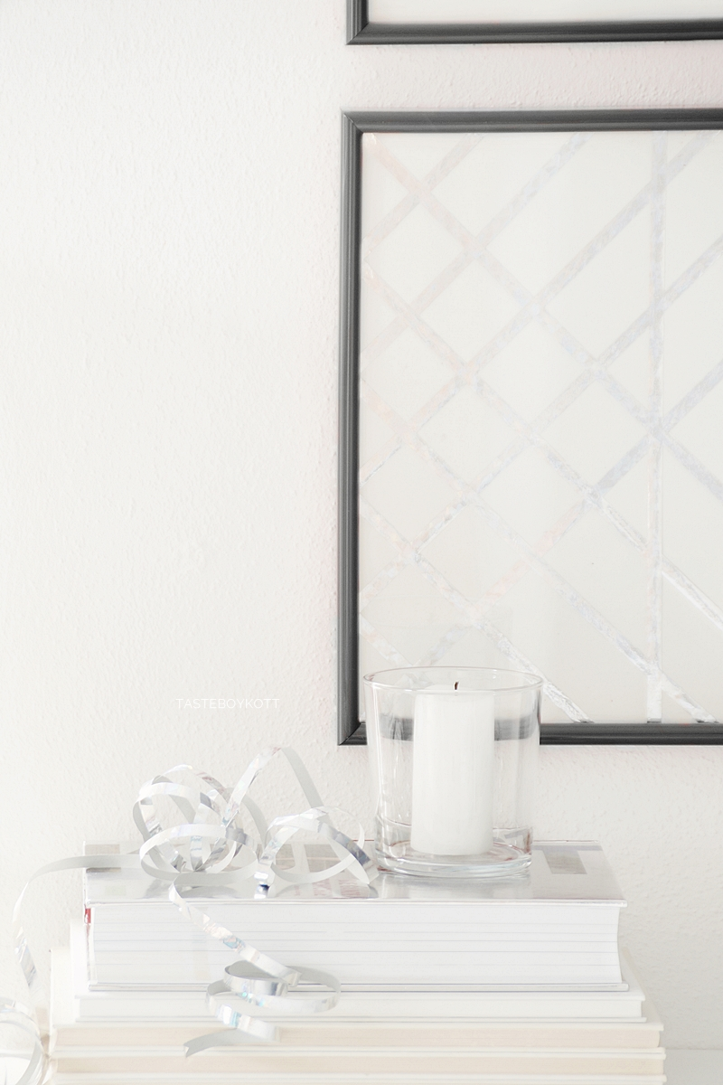 Einfache geometrische günstige DIY-Kunst Upcycling Wanddeko aus silbernen Metallic-Luftschlangen. Tasteboykott Blog.