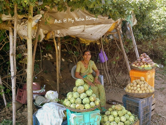 A village woman sells figs, custard apples on the Pune-Saswad Dive Ghat Highway
